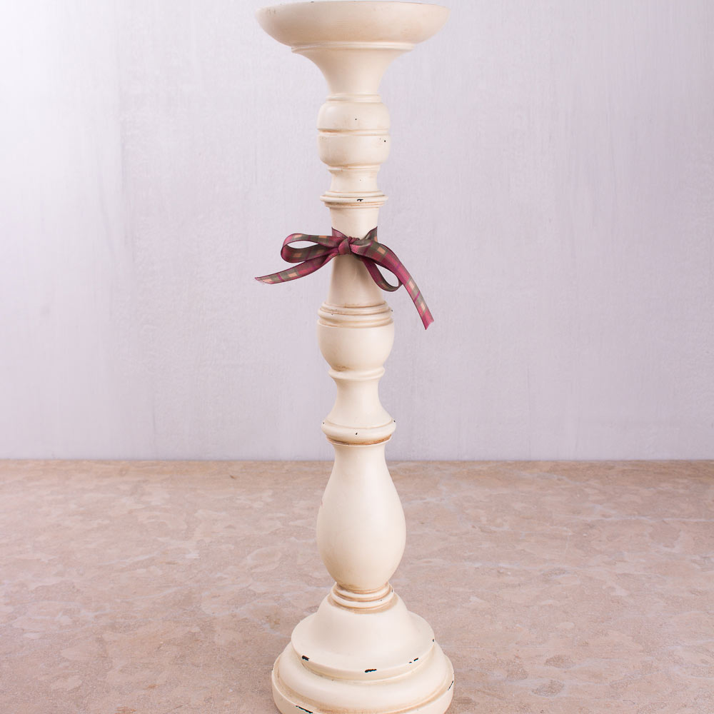 Four large candle stick holders 0