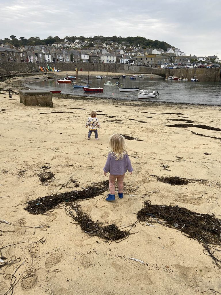 Delilah and her friend Darcy on Mousehole beach