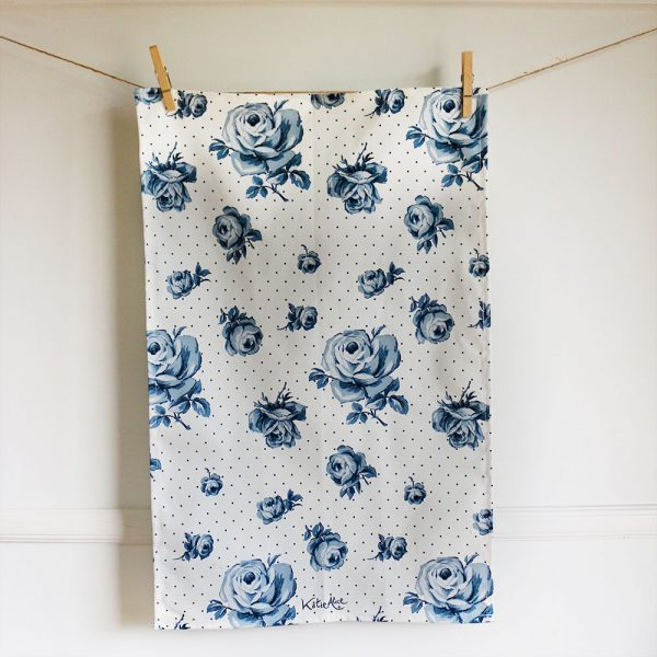 Vintage Indigo tea towel hanging up against a white wall