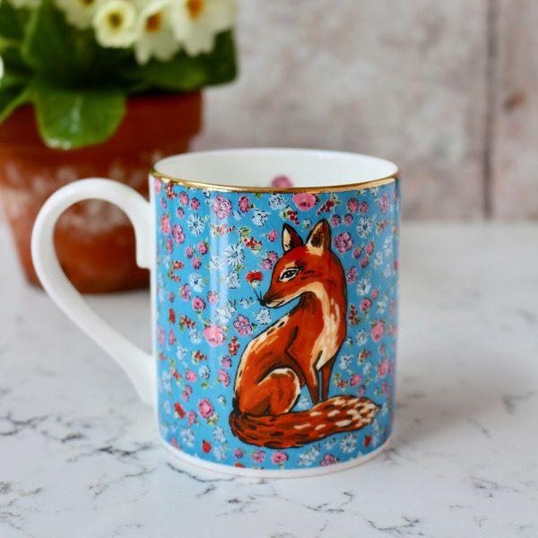 Blue floral mug with fox motif