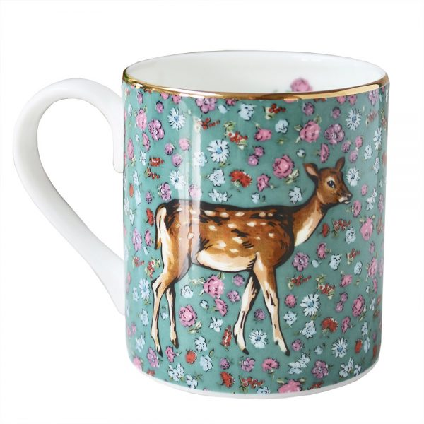 green floral mug with deer motif