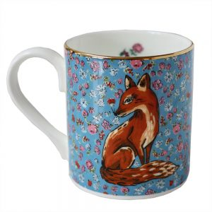 Blue floral mug with fox illustration