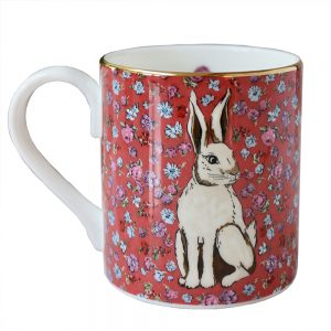 red floral mug with white hare motif