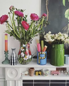 Colourful mantlepiece of flowers - Pippa Janey Stylist