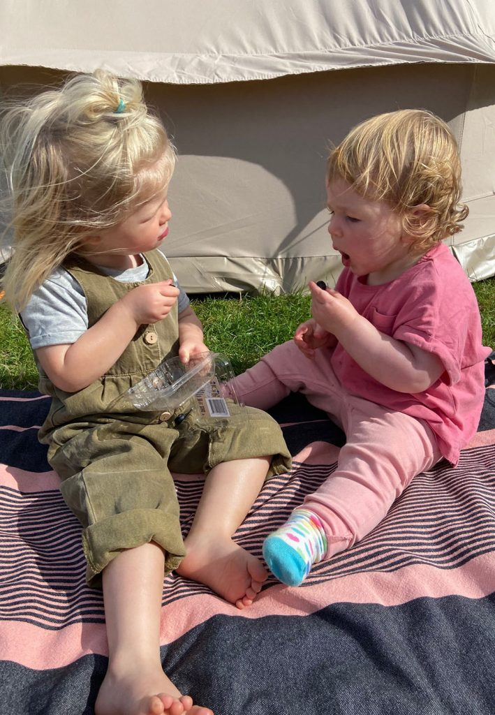 snacking on blueberries - camping with a toddler
