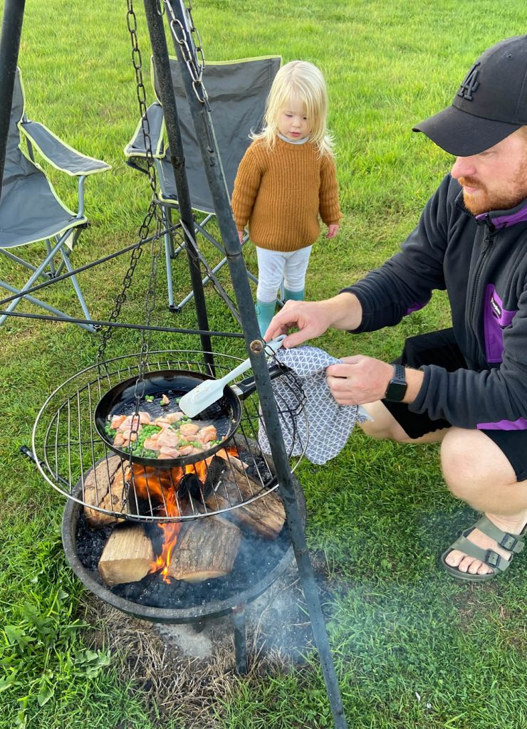 Cooking over a fire pit - camping with a toddler