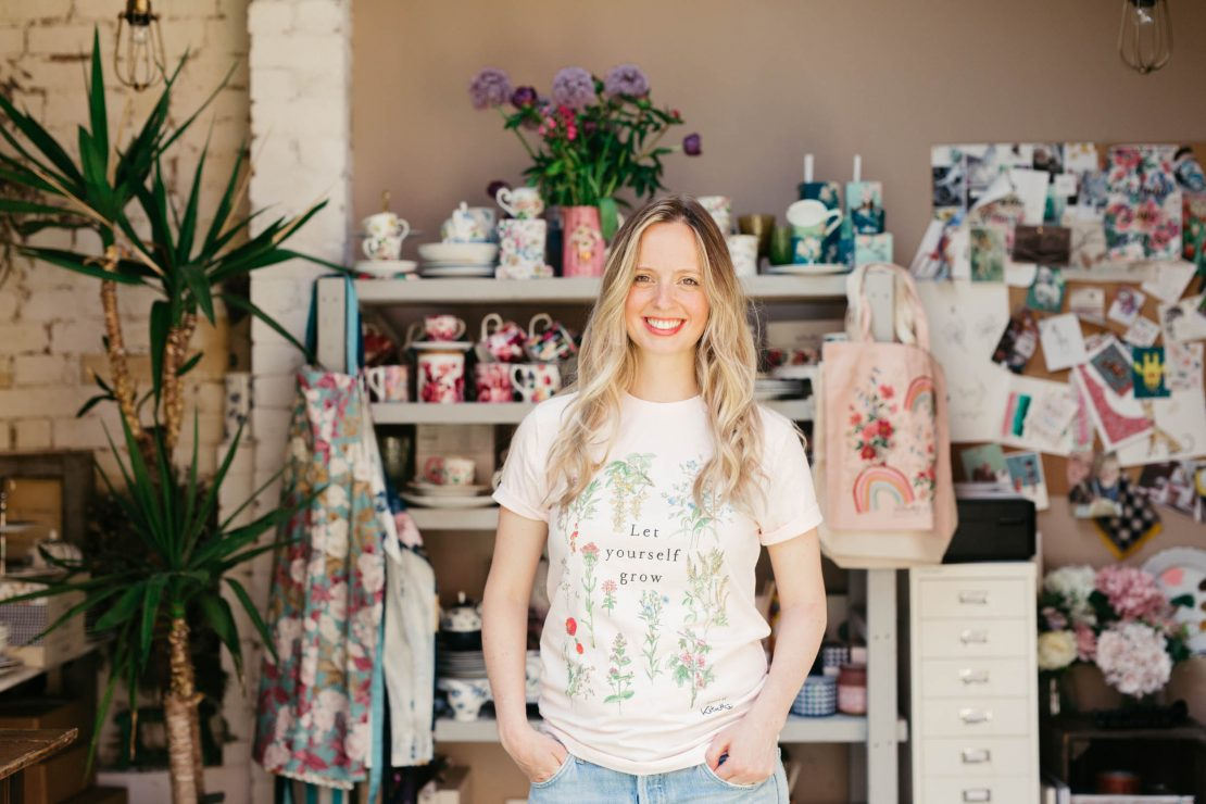 Katie in the Let Yourself Grow botanical print t-shirt
